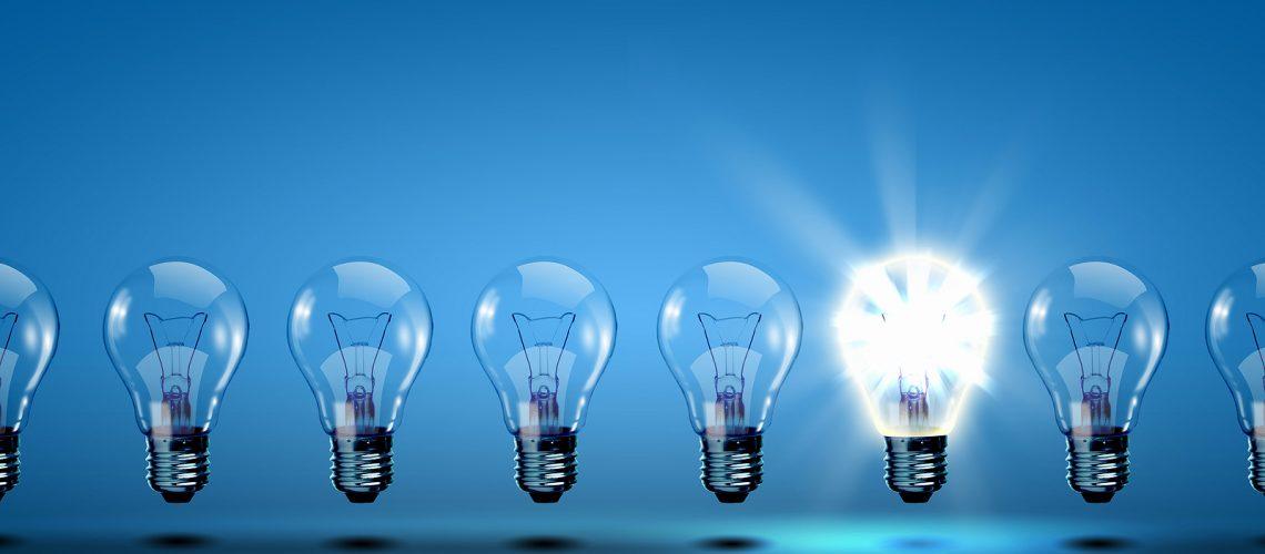 bigstock_row_of_light_bulbs_with_one_di_21893966